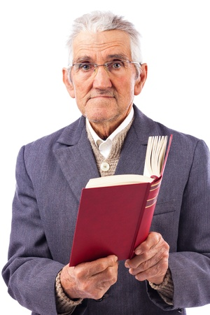 Portrait of an old man with glasses holding a red book over white background photo