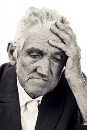 Portrait of a thoughtful old man on white  Black and white Stock Photo