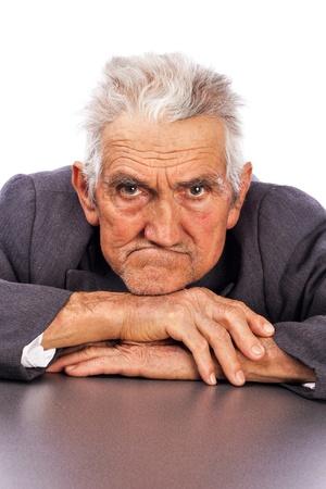 Portrait of an expressive old man against white background Standard-Bild