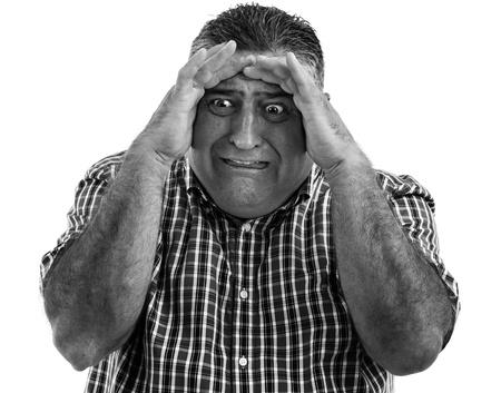 Monochrome portrait of a terrified man  Stock Photo