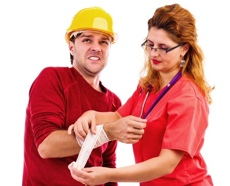 accident at work: Female doctor nurse putting  a bandage to a worker hand, injured hand, on white background