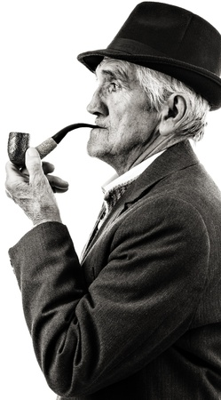 Closeup portrait of a senior smoking a pipe. Black and white photo