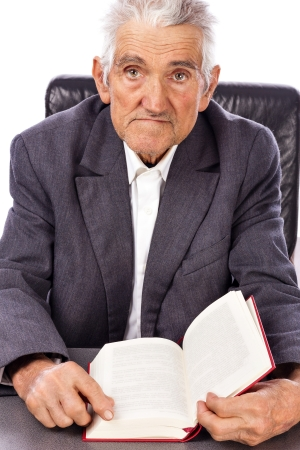 Senior with a book looking at camera against white background photo