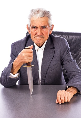 Furious senior with a knife looking at camera isolated on white background Stock Photo