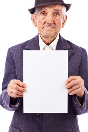 one sheet: Elderly serious  man holding an empty white sheet of paper, isolated on white background