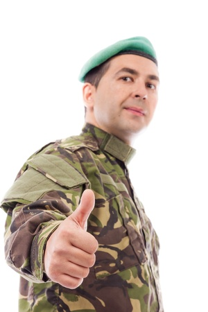 Young army soldier with thumb up isolated on white background Stock Photo