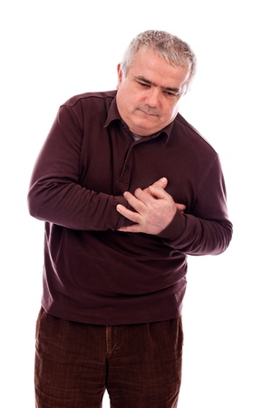 sudio: Senior man with chest pain isolated on  white background