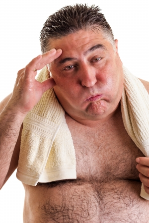 miffed: Closeup portrait of an exausted fat man after doing exercises isolated on white background