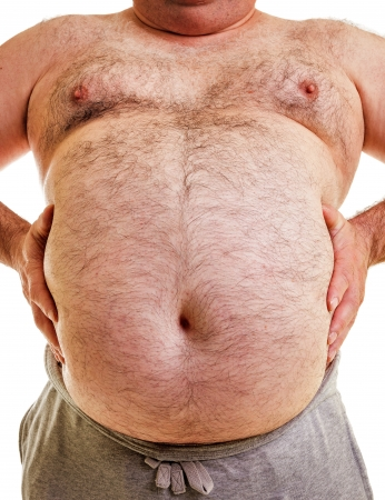 overweight: Closeup portrait of a big belly on white background