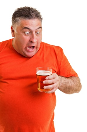 Portrait of an expressive fat man drinking beer isolated on white background photo