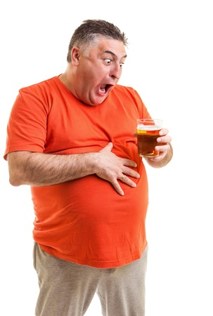 Portrait of a thirsty fat man staring at a glass of beer isolated on white background photo