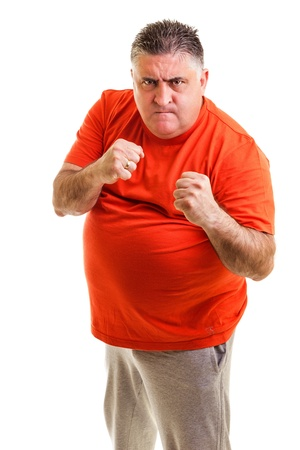 Furious man clenching his fists, ready to fight, against white background Stock Photo