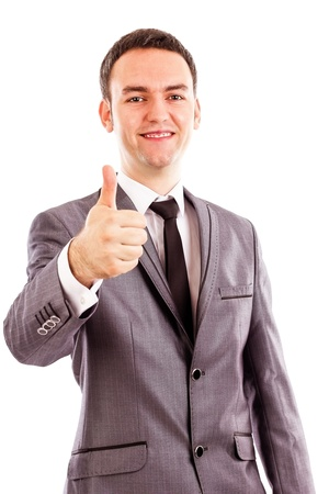 Happy smiling young business man with thumb up gesture over white background photo