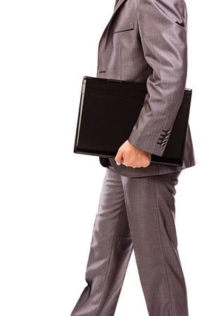 Businessman with laptop under his arm on white background Stock Photo