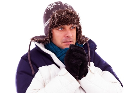 tremble: Young man rubbing his hands from cold in wintertime Stock Photo