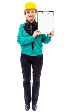Young woman engineer with yellow hard hat holding clipboard isolated on white background photo