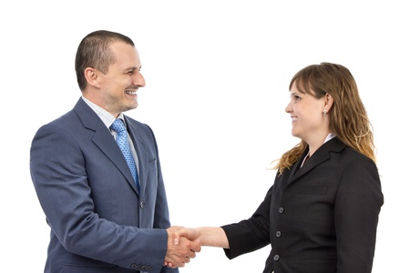 Portrait of successful business people shaking hands on a deal on a white background photo