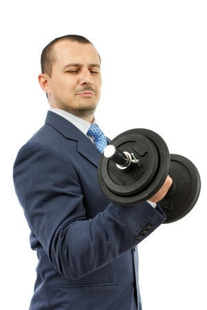 Strong business man with dumbbell isolated on a white background photo