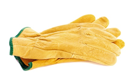 Pair of protective yellow gloves isolated on white
