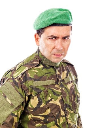 Portrait of an angry soldier with green beret  against white background photo