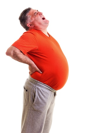 Overweight man with acute back ache bending over backwards to attenuate the pain with an agonised expression on his face against white