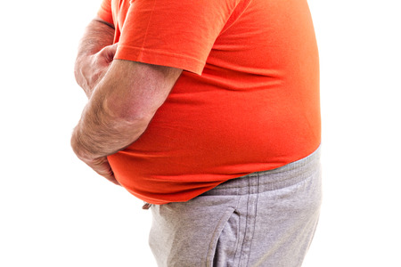 Man holding both hands on his aching stomach, closeup, isolated on white  photo