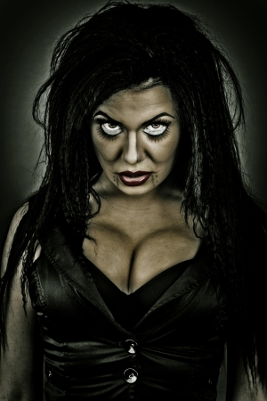 Portrait of a brunette woman with creepy look photo