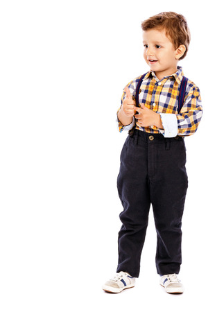 full lenght: Full lenght portrait of an adorable little boy showing thumbs up isolated one white