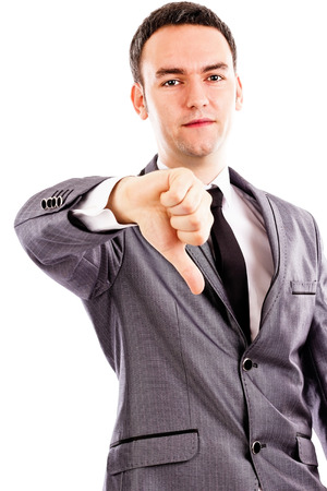 disapprove: Disappointed young business man showing thumb down sign isolated on white