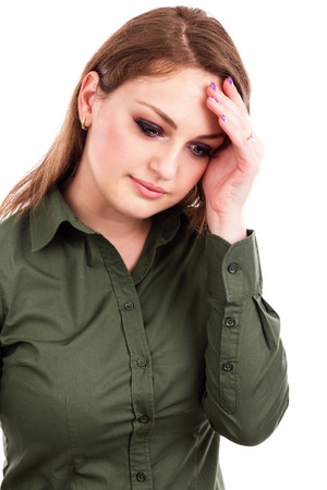 Close up portrait of a pretty young  business woman with headache on white photo