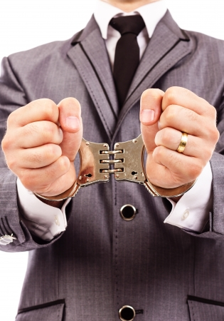 Closeup portrait of a  handcuffed hands. White background Stock Photo - 24114118