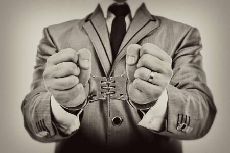 Monochrome portrait of a businessman's hands with handcuffs Stock Photo - 24125863