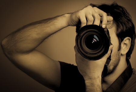 Young man with professional camera Stock Photo