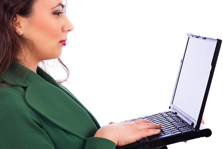 Closeup portrait of a pretty young businesswoman holding a laptop isolated on white background photo