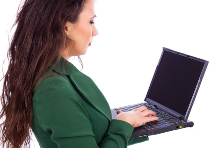 Beautiful young businesswoman holding a laptop against white background photo