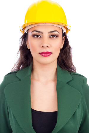 Portrait of young businesswoman with hard hat on white background photo