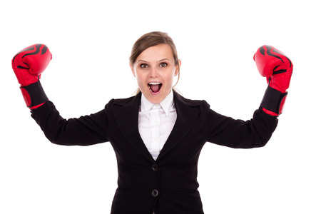 Young successful businesswoman celebrating wearing boxing gloves  isolated over white background photo