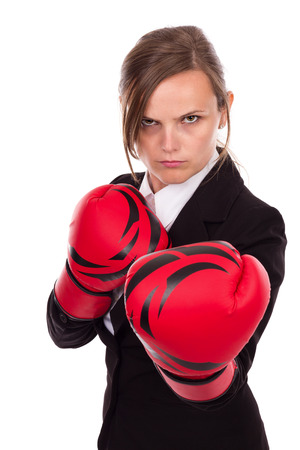 Young businesswoman wearing boxing gloves ready for the competition isolated over white background photo