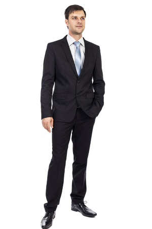 full lenght: Full lenght portrait of happy young business man with hand in his pocket over white background