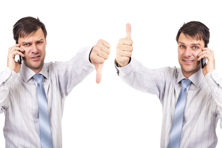 Portrait of two businesspeople with thumbs up and down isolated over white background