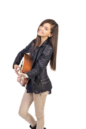 woman guitar: Beautiful teenager playing guitar and singing  isolated on white background