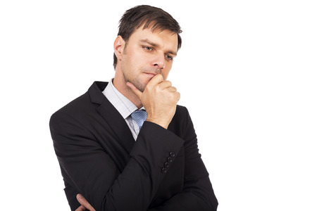 memorize: Portrait of young thoughtful young businessman isolated over white background