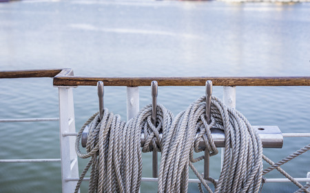 coiled rope: Closeup of coiled rope on a ship deck in summer