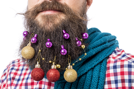 Closeup portrait of man with decoration balls in his beard over white background photo