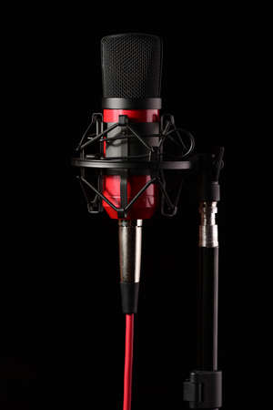 condenser: Professional recording studio condenser microphone attached to shock mount, isolated on black background Stock Photo