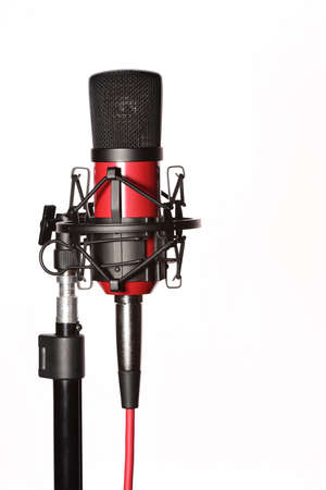 Professional studio condenser microphone attached to shock mount, isolated on white background