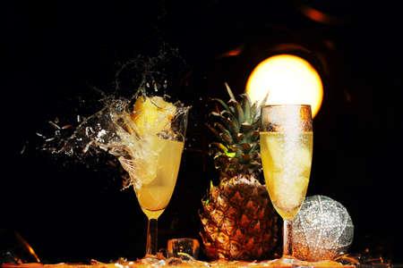gunshot: Shattering from gunshot champagne glasses with spilling liquid isolated on black