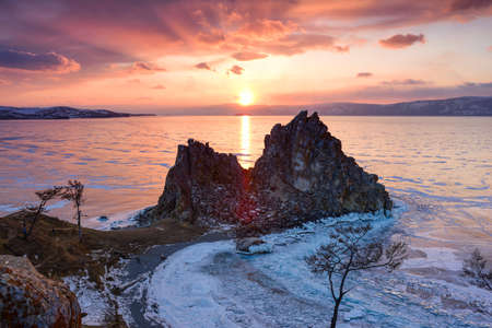 stunning: Stunning sunset above the frozen surface of the lake Baikal on the Olkhon iceland