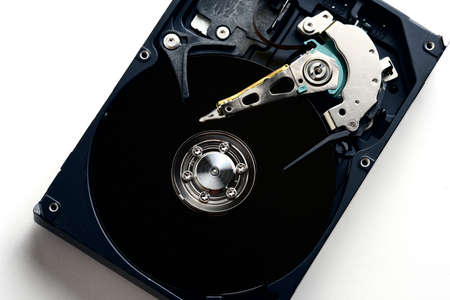 internals: Hard disk drive internals inside close up with black disc surface and heads exposed