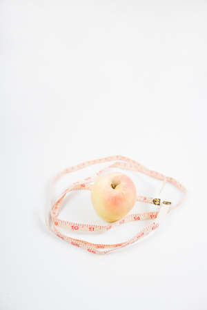 measurement tape: an apple with measurement tape Stock Photo